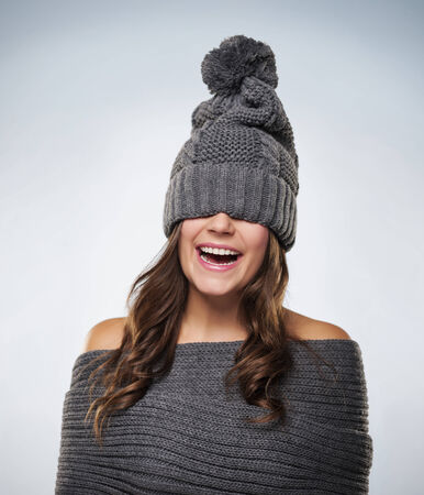 Young woman have fun with wool clothes photo