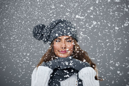 Beautiful young woman enjoys first snow