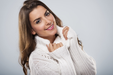 Beautiful woman wearing white warm sweater photo