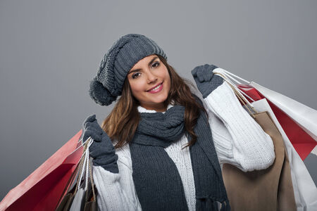 gloves women: Smiling woman during the winter sale Stock Photo