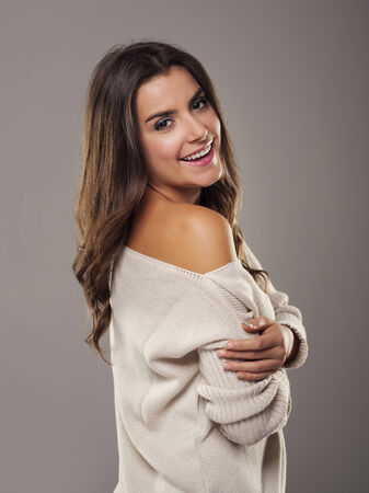 Beauty and natural woman wearing oversized sweater photo