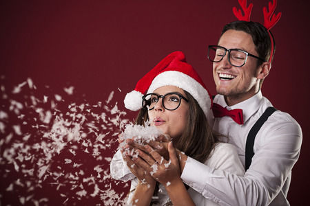 glass eye: Sweet nerd couple blowing snow