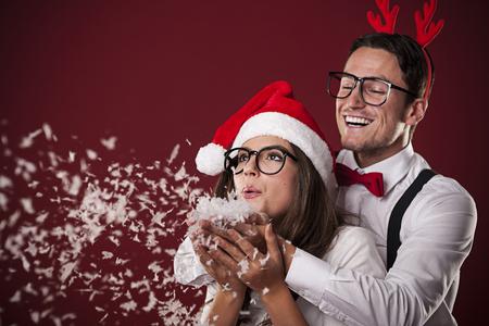 Sweet nerd couple blowing snow