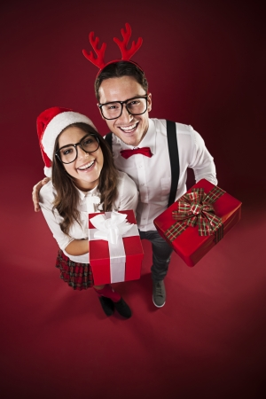 Portrait of funny couple with christmas present  photo