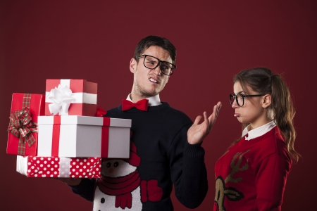 Rude nerdy man with christmas gifts photo