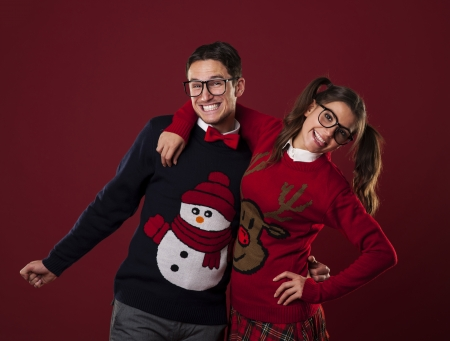 Portrait of nerd couple wearing funny sweaters  Stock Photo