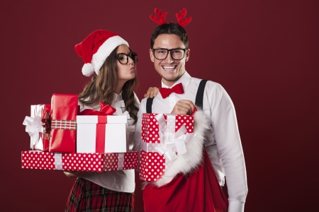Loving couple with a lot of christmas gifts  photo