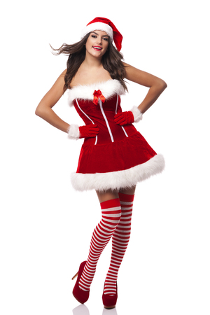 Beautiful and smiling santa claus woman  photo