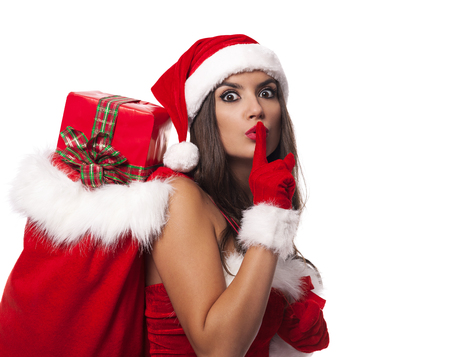 Shocked Mrs claus showing silence sign  photo