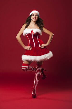 Beautiful woman wearing santa claus costume photo