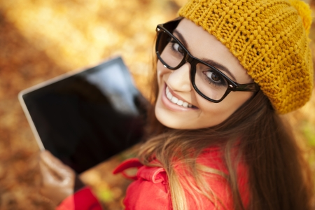 Smiling young woman using digital tablet  photo