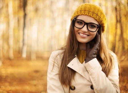 fashion glasses: Portrait of beautiful woman at autumn Stock Photo