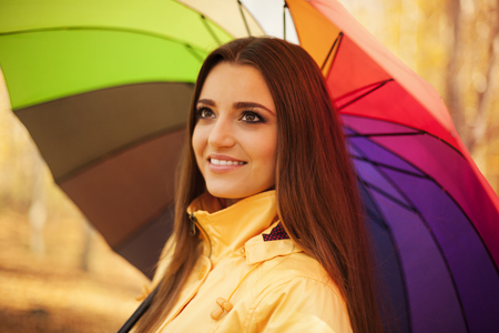 woman umbrella: Smiling woman standing under the umbrella
