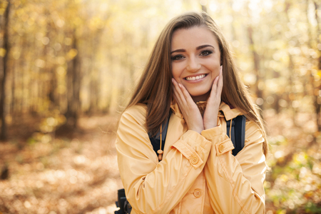 Portrait of young happy woman during the autumn hiking photo