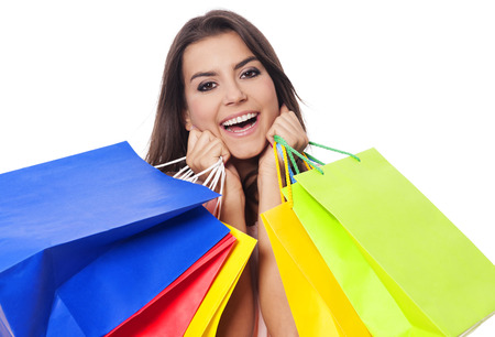 Happy woman with full of shopping bags  photo