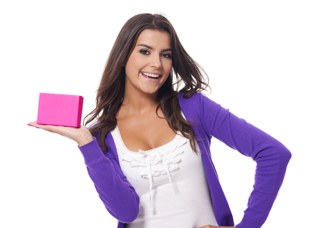Cute young woman holding pink present   photo