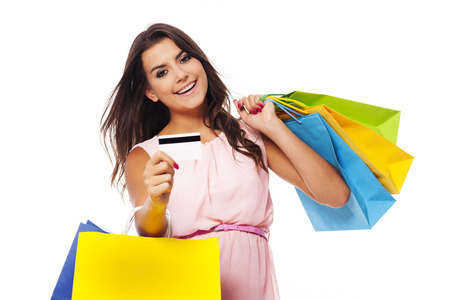 Gorgeous female with multi colored shopping bag and credit card Stock Photo - 23260753