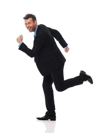 hurry up: Bello e sorridente uomo d'affari sbrigati