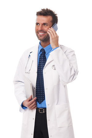 Happy male doctor talking on mobile phone  photo