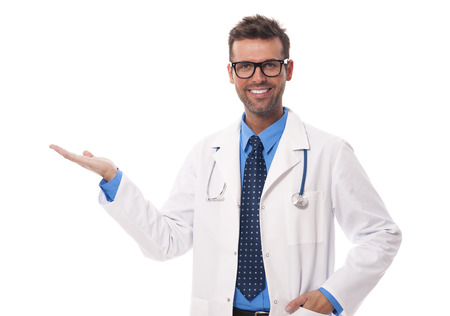 Happy doctor wearing glasses presenting something photo