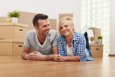 Portrait of smiling young marriage in new home  photo