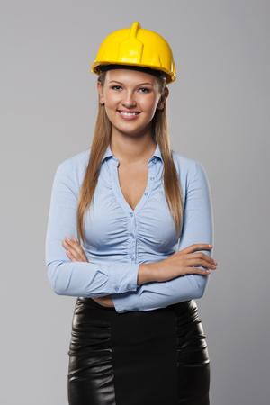 female construction worker: Portrait of beautiful architect woman