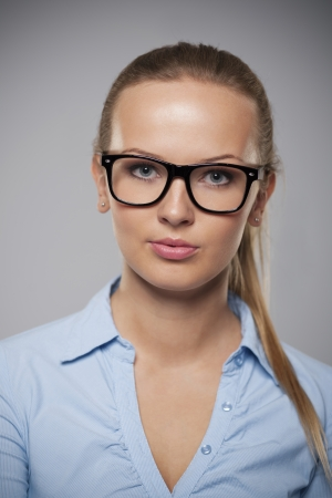 Portrait of beautiful businesswoman wearing fashion glasses  photo