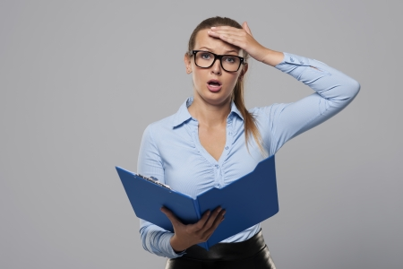 Shocked businesswoman make a mistake in office documents  photo