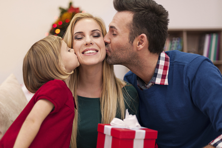 home interiors: Portrait of affectionate family in christmas time  Stock Photo