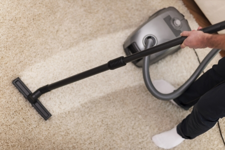Close up of vacuuming a carpet  photo
