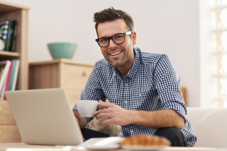 Portrait of smiling man working at home  Stock Photo - 24831171