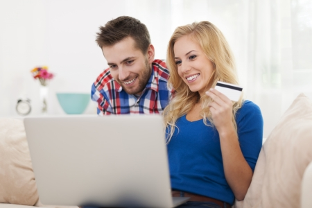 Smiling couple during the shopping online photo