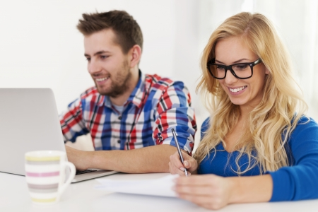 Couple paying bills at home  photo