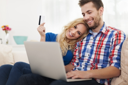 Young couple paying online by credit card  photo