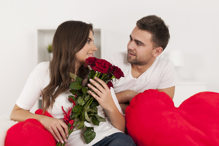 Happy loving couple with red rose photo