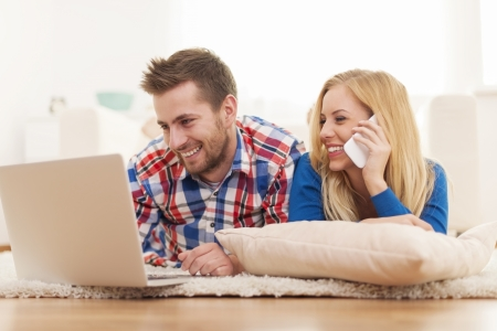 Young couple making online order  Stock Photo - 25082345