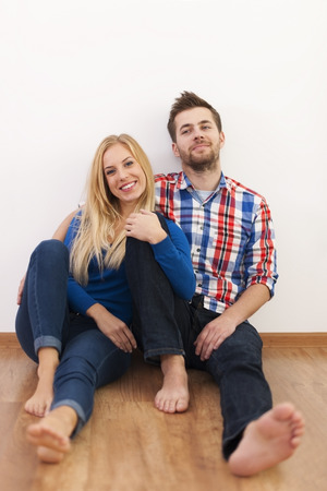 Portrait of relaxed couple on floor photo