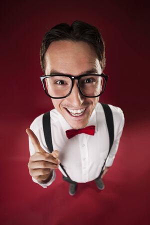 Funny nerdy man wearing big glasses  photo