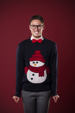 Portrait of funny man wearing sweater with snowman  photo