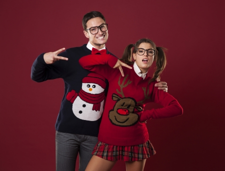 Funny nerd couple pretending to be self-confident photo