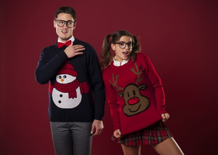 ugliness: Crazy nerd couple in funny sweaters goofing around