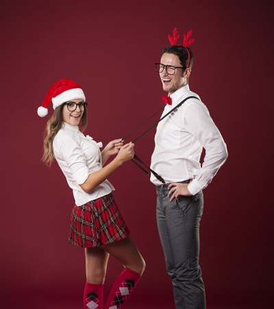 Cute couple flirting in christmas time  photo