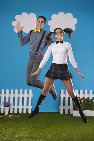 glass fence: Funny nerdy couple jumping in farm