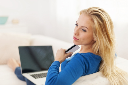 Woman wondering about online shopping  photo
