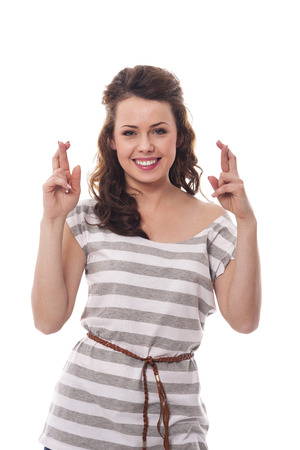 Smiling woman with fingers crossed  photo