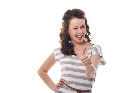 Beautiful woman winking and showing thumbs up Stock Photo