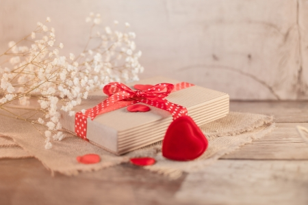 Valentines gift and hearts decorations on wood  photo