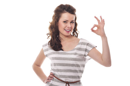 Smiling woman gesturing OK sign  photo