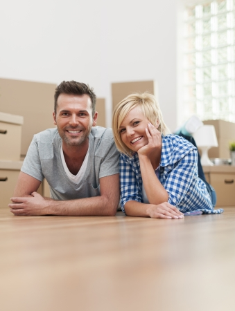 Portrait of happy couple on hardwood floor  photo