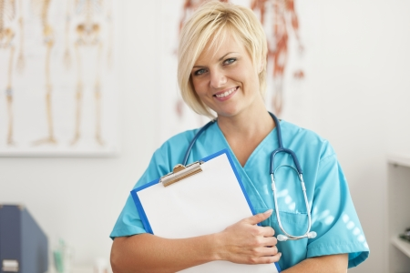 Portrait of smiling blonde female surgeon photo
